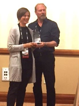 Douglas Coler presents the IMTY Award to Heather Nielsen at the IMTAL Luncheon